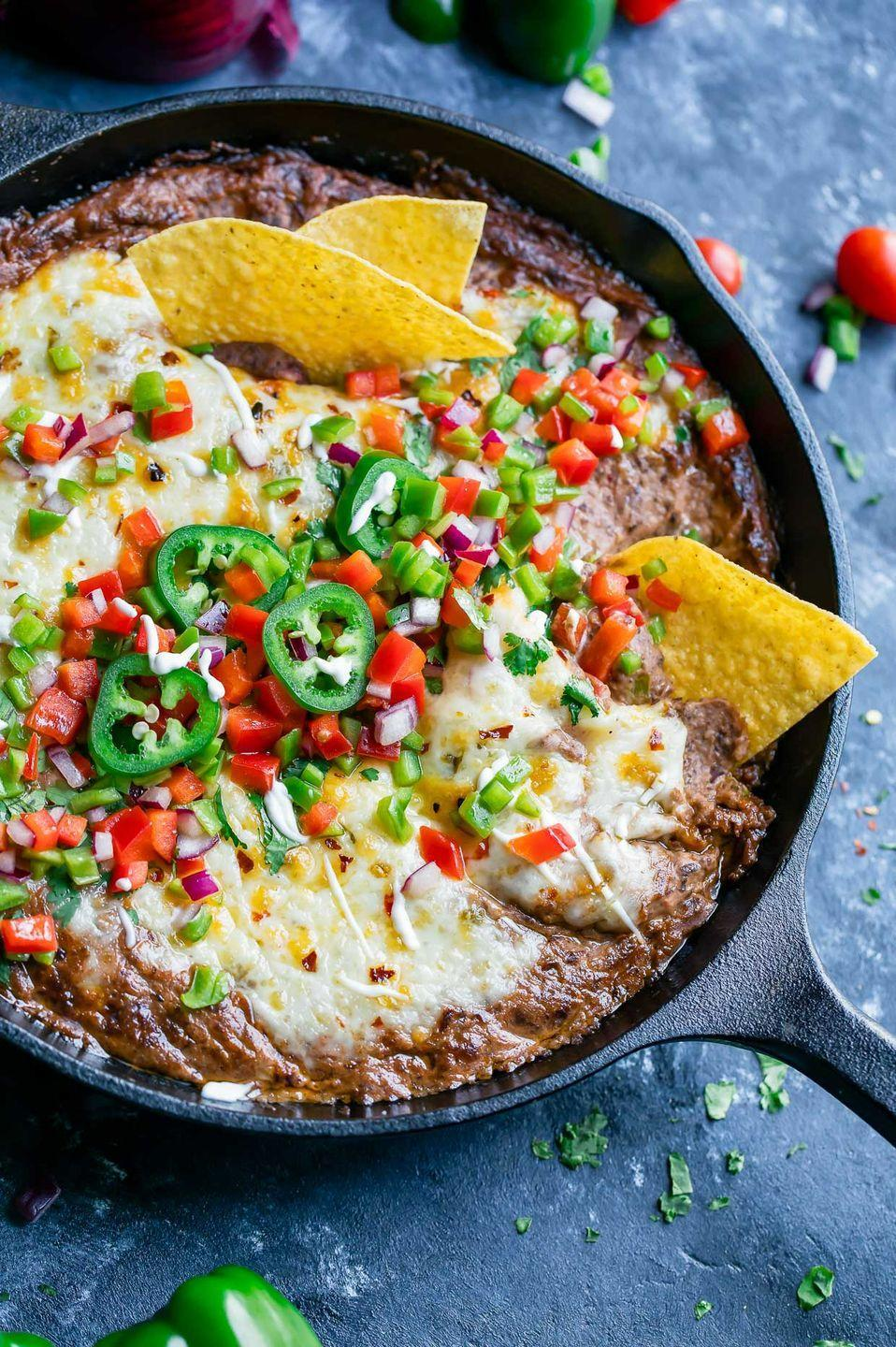"<p>The Instant Pot allows you to make this dip on the cheap because you can opt for a bag of dried beans instead of a can!</p><p>Get the recipe from <a href=""https://peasandcrayons.com/2017/09/instant-pot-black-bean-dip.html"" rel=""nofollow noopener"" target=""_blank"" data-ylk=""slk:Peas and Crayons"" class=""link rapid-noclick-resp"">Peas and Crayons</a>.</p>"