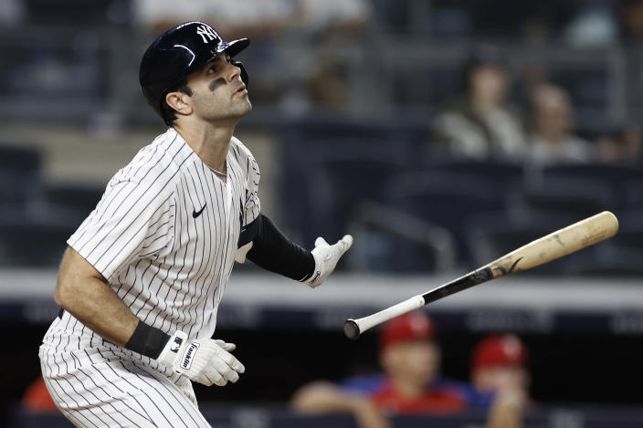 New York Yankees' Ryan LaMarre watches his single that drove in the winning run against the Philadelphia Phillies during the 10th inning of a baseball game Wednesday, July 21, 2021, in New York. The Yankees won 6-5. (AP Photo/Adam Hunger)