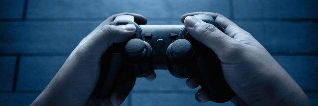 A game controller playing video games