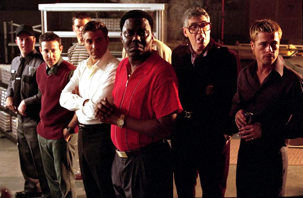 "<a href=""http://movies.yahoo.com/movie/1804713423/info"">Ocean's Eleven</a> (2001): His remake of the 1960 Rat Pack caper is perfect escapist entertainment: fun and fast-paced, slick and spontaneous, light and full of laughs. Clooney, Roberts, Matt Damon and Brad Pitt are clearly having a ball bouncing off each other, never taking themselves too seriously despite their Hollywood heavyweight status. Clooney stars in the Frank Sinatra role as Danny Ocean, who amasses a rag-tag crew of cons to pull off his latest heist: a robbery of Las Vegas' biggest casinos on the night of a heavyweight championship fight, when he knows the high rollers will be in town and the vault will hold about $150 million. The fact that this is preposterous, yet goes so smoothly, is only part of why it's such a kick."