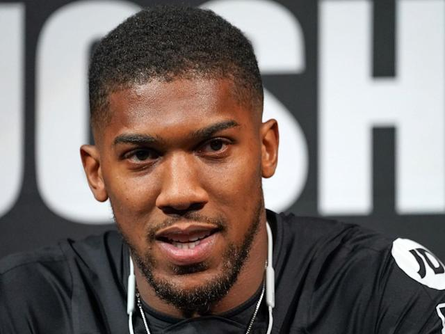 Anthony Joshua speaking at a press conference ahead of the rematch: Getty