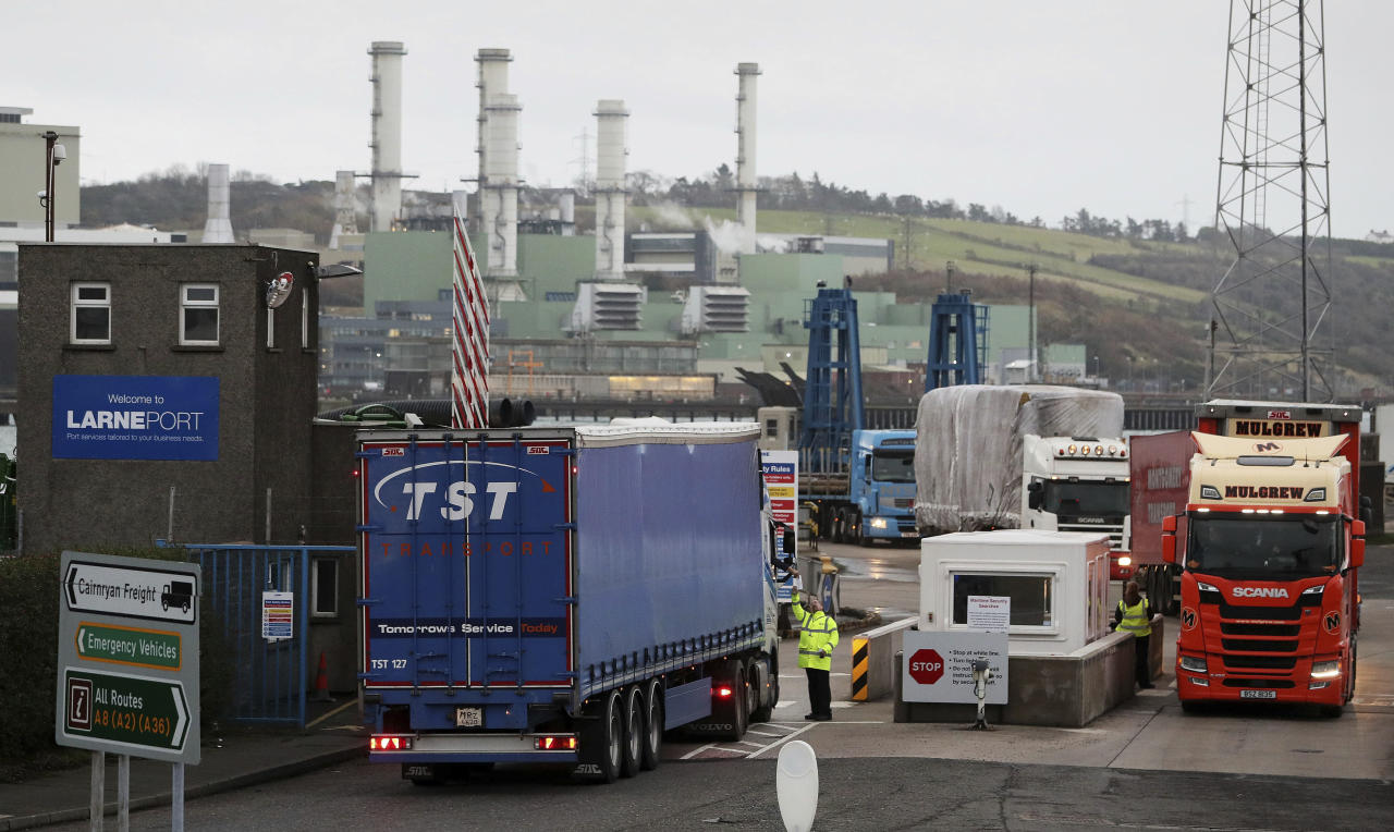 Vehicles arrive at Larne Port in Northern Ireland, Wednesday, Nov. 14, 2018. British Prime Minister Theresa May is set to face her divided Cabinet in a bid to win support for a draft Brexit deal with the European Union. Negotiators from the two sides have reached agreement on divorce terms, including a plan to resolve the key issue of the Irish border. (Brian Lawless/PA via AP)