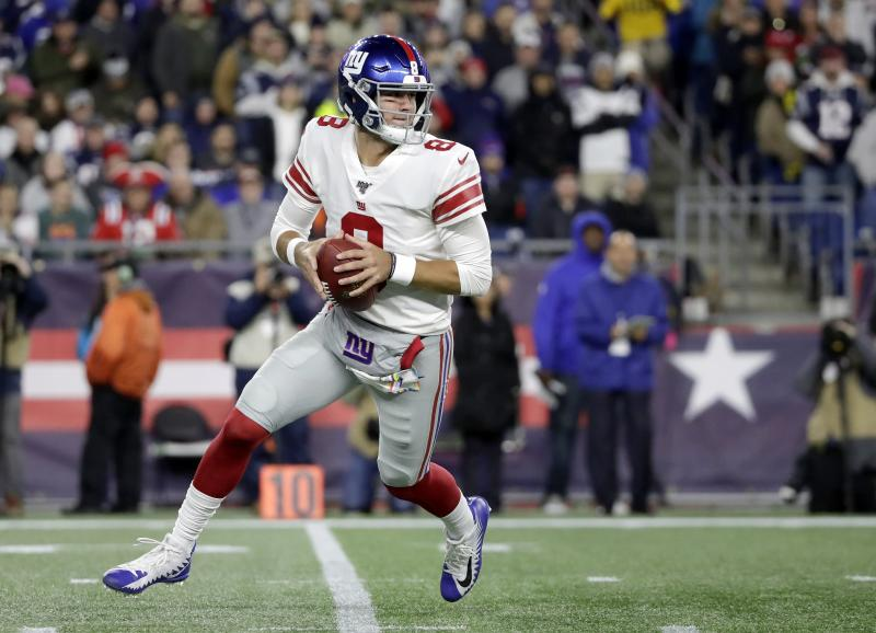 New York Giants quarterback Daniel Jones rolls out to pass against the New England Patriots in the first half of an NFL football game, Thursday, Oct. 10, 2019, in Foxborough, Mass. (AP Photo/Elise Amendola)