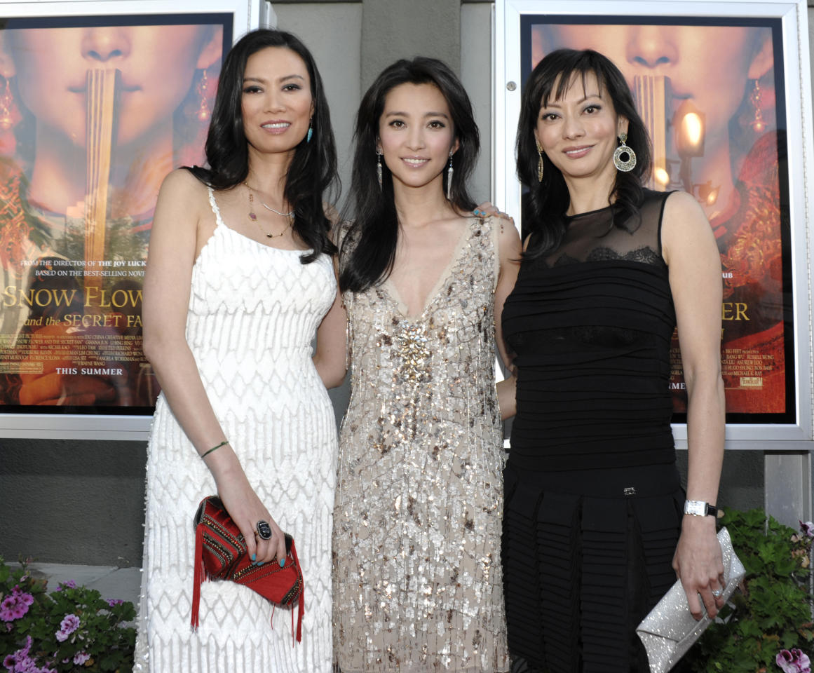"Producer Wendi Murdoch, left, actress Li Bingbing, center, and producer Florence Sloan arrive at the premiere of the feature film ""Snow Flower and the Secret Fan"" in Los Angeles on Monday, July 11, 2011. The film opens in theaters on July 15. (AP Photo/Dan Steinberg)"