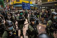 Hundreds of riot police flooded the Mong Kok district of Kowloon in a bid to thwart online calls for flash mob protests to mark the suspended vote