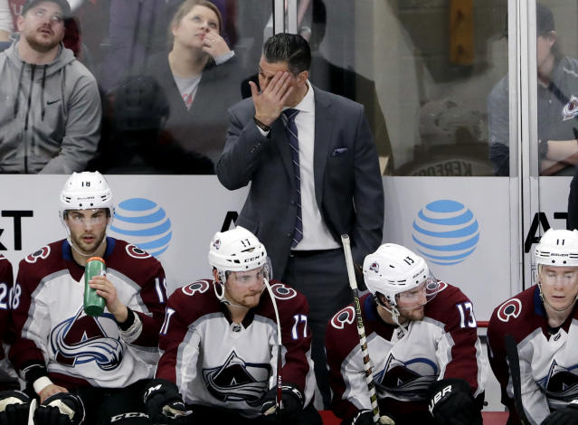 Colorado Avalanche coach Jared Bednar wipes his face during the third period of the team's NHL hockey game against the Chicago Blackhawks, Sunday, March 24, 2019, in Chicago. The Blackhawks won 2-1 in overtime. (AP Photo/Nam Y. Huh)