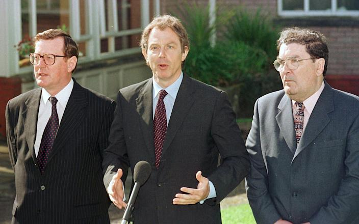 Lord Trimble (left) standing alongside Tony Blair and John Hume in 1988 ahead of a referendum on the GFA