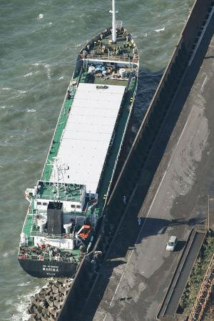 A cargo ship washed ashore by Typhoon Trami is seen in Kawasaki, Japan, in this photo taken by Kyodo October 1, 2018. Mandatory credit Kyodo/via REUTERS