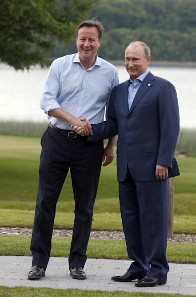 Britain's Prime Minister David Cameron, left, shakes hands with Russian President Vladimir Putin during arrivals for the G-8 summit at the Lough Erne Golf Resort in Enniskillen, Northern Ireland on Monday, June 17, 2013. (AP Photo/Lefteris Pitarakis)