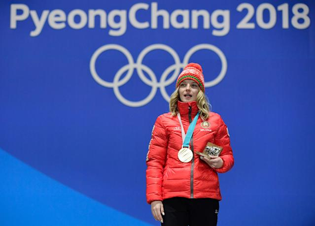 <p>Belarus' gold medallist Hanna Huskova poses on the podium during the medal ceremony for the freestyle skiing women's aerials at the Pyeongchang Medals Plaza during the Pyeongchang 2018 Winter Olympic Games. (Getty) </p>