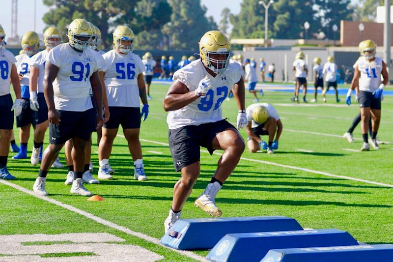 Defensive lineman Osa Odighizuwa participates in an agility drill during a team practice session in October 2019.