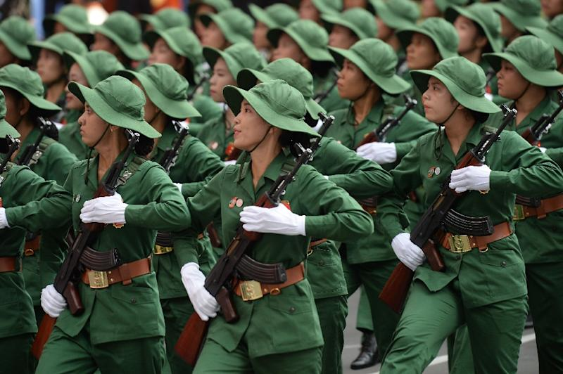 Female soldiers dressed as Vietnam war era Vietcong soldiers march during a parade in Ho Chi Minh City on April 30, 2015 marking the 40th anniversary of the fall of Saigon (AFP Photo/Hoang Dinh Nam)