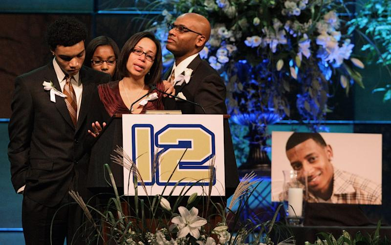 "FILE - Hundreds, including DJ's brother Kyle Henry, right, DJ's sister Amber Henry, second from right, and best friend Brandon Cox, third from right, showed up for the candlelight prayer vigil held in Easton, Oct. 18, 2010, in honor of the late Danroy ""DJ"" Henry Jr., who was shot and killed by a police officer in New York."