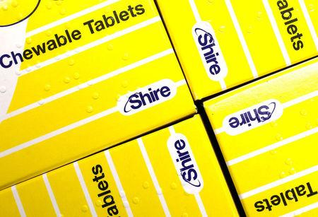 FILE PHOTO: Vitamins made by Shire are displayed at a chemist's in northwest London, Britain, July 11, 2014. REUTERS/Suzanne Plunkett/File Photo