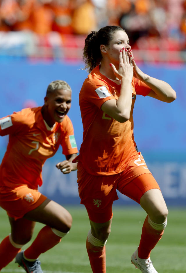 Netherlands' Dominique Bloodworth, right, celebrates after scoring her side's 2nd goal during the Women's World Cup Group E soccer match between the Netherlands and Cameroon at the Stade du Hainaut in Valenciennes, France, Saturday, June 15, 2019. (AP Photo/Michel Spingler)