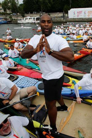 Olympic Judo champion Teddy Riner poses in a canoe on the River Seine in Paris, France, June 23, 2017 as Paris transforms into a giant Olympic park to celebrate International Olympic Days with a variety of sporting events for the public across the city during two days as the city bids to host the 2024 Olympic and Paralympic Games.  REUTERS/Jean-Paul Pelissier