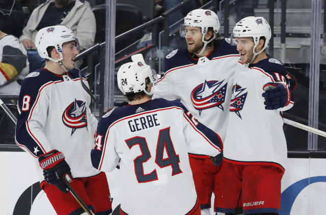 Columbus Blue Jackets center Alexander Wennberg, right, is congratulated after scoring against the Vegas Golden Knights during the third period of an NHL hockey game Saturday, Jan. 11, 2020, in Las Vegas. (AP Photo/John Locher)