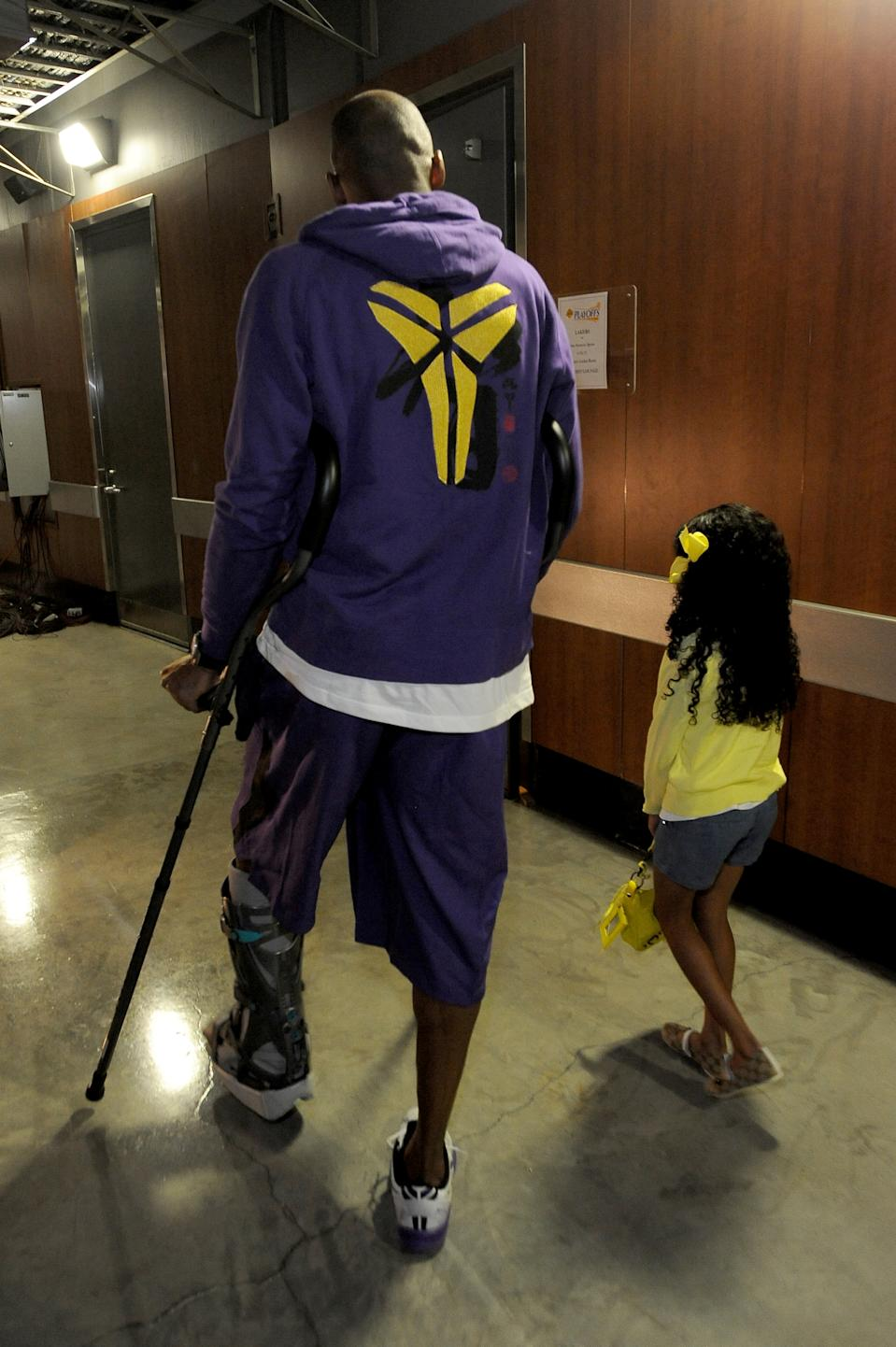 Kobe Bryant #24 of the Los Angeles Lakers walks with his daughter Gianna Maria-Onore Bryant at Staples Center prior Game Four of the Western Conference Quarterfinals against the San Antonio Spurs during the 2013 NBA Playoffs on April 28, 2013 in Los Angeles, California. (Photo by Andrew D. Bernstein/NBAE via Getty Images)