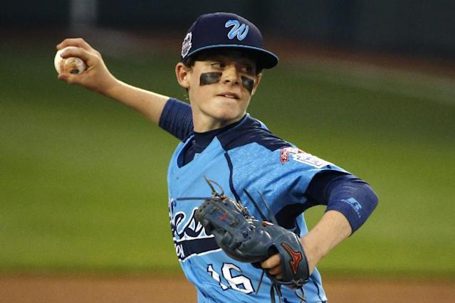 Las Vegas pitcher Brad Stone delivers during the first inning of a United States semi-final baseball game against Philadelphia at the Little League World Series tournament in South Williamsport, Pa., Wednesday, Aug. 20, 2014. (AP Photo/Gene J. Puskar)