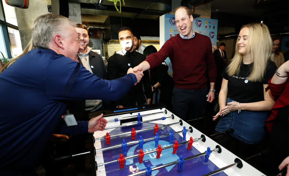 LONDON, ENGLAND - FEBRUARY 05: Prince William, Duke of Cambridge shakes hands with a guest as he plays table football while launching The Heads Up Weekends on February 5, 2020 in London, England. The prince who is President of the Football Association (FA), attended a special event in London to launch The Heads Up Weekends, which will see every football team from all the leagues dedicate their matches to Heads Up, to highlight the importance of talking about mental health. (Photo by Frank Augstein - WPA Pool/Getty Images)