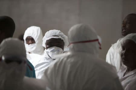 Health workers wearing protective equipment stand at the Island Clinic in Monrovia, September 30, 2014, where patients are treated for Ebola. REUTERS/Christopher Black/WHO/Handout via Reuters