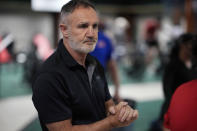 """FILE - In this Monday, June 7, 2021, file photo, USA Boxing head coach Billy Walsh takes part in drills during a media day for the team in a gym located in a converted Macy's Department store in Colorado Springs, Colo. After a half-decade of turmoil and drama at the highest levels of Olympic boxing, the sport's trip to Tokyo looks as if it could be fairly smooth. At least as smooth as this notoriously chaotic sport ever gets. """"I hope it'll be a situation where we get to see the best boxers rewarded for the best performances,"""" Walsh said. (AP Photo/David Zalubowski, File)"""