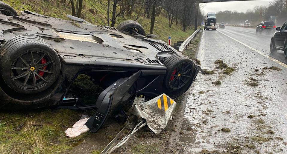 A flipped over Ferrari is seen on the M621 in England.