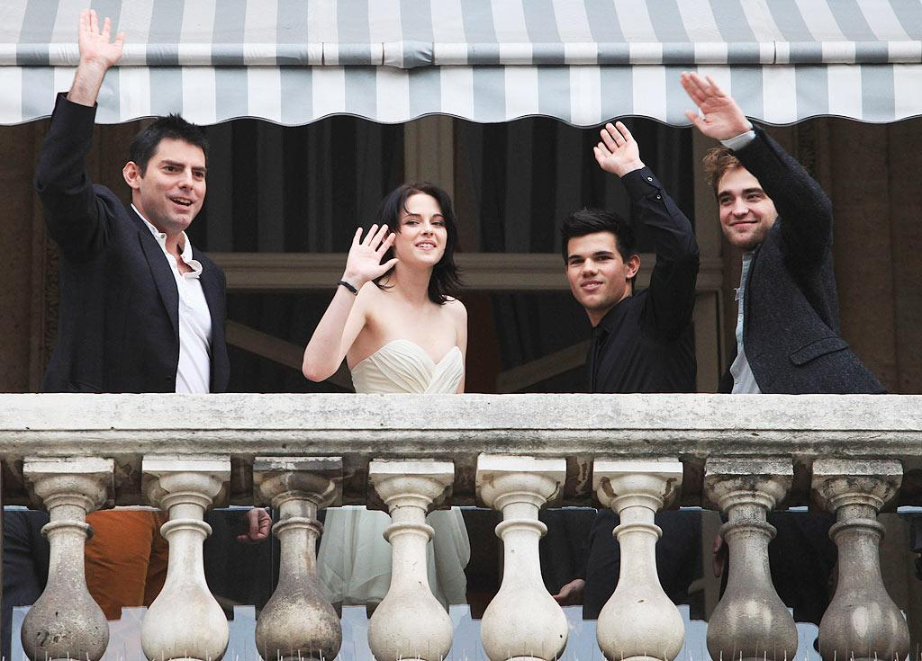 "What a difference a year makes! Taylor and his co-stars Kristen Stewart and R-Patz looked chic and sophisticated as they promoted the second ""Twilight"" film in France alongside director Chris Weitz. Yves Forestier/<a href=""http://www.gettyimages.com/"" target=""new"">GettyImages.com</a> - November 10, 2009"