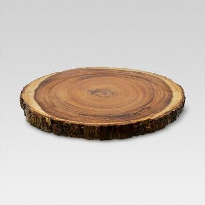 "<p>Charcuterie board enthusiasts will love the <span>Threshold 15"" Acacia Wood Round Serving Platter</span> ($17).</p>"