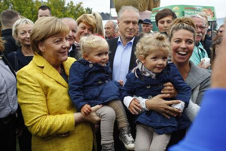 German Chancellor Merkel visits harvest festival in Lauterbach