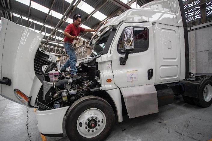 Mexico's truckers are having their rigs armored to defend against powerful drug cartels and other organized crime groups - here, a semi is being upgraded at a plant in Ecatepec (AFP Photo/Pedro PARDO)