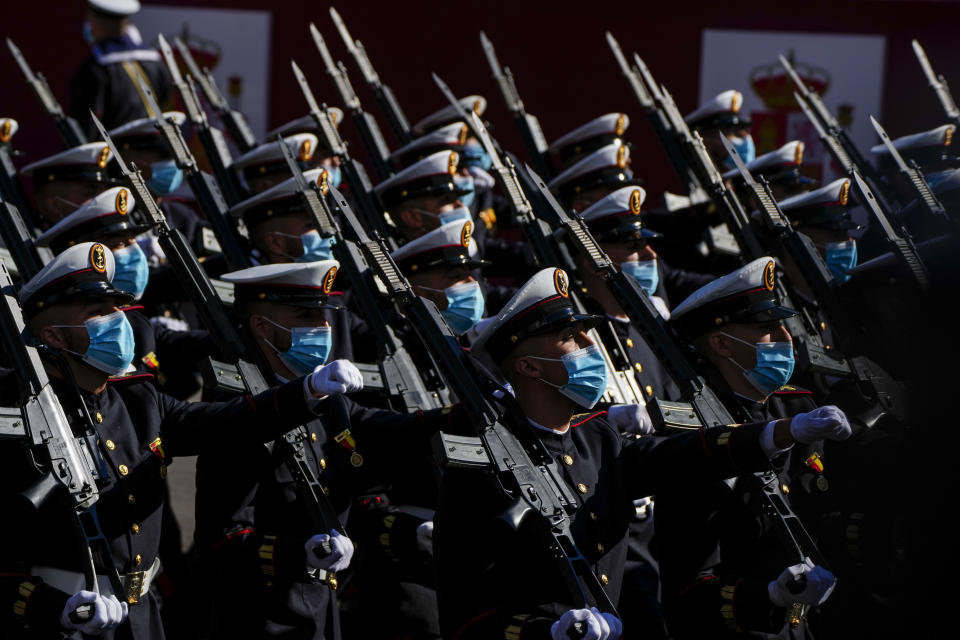 Soldiers attend a military parade as they celebrate 'Dia de la Hispanidad' or Hispanic Day in Madrid, Spain, Tuesday, Oct. 12, 2021. Spain commemorates Christopher Columbus' arrival in the New World and also Spain's armed forces day. (AP Photo/Manu Fernandez)