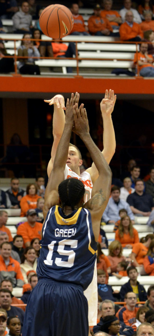 Syracuse's Trevor Cooney shoots over Ryerson's Kadeem Green during the second half of a men's NCAA exhibition basketball game in Syracuse, N.Y., Tuesday, Nov. 5, 2013. Syracuse won 81-46. (AP Photo/Kevin Rivoli)