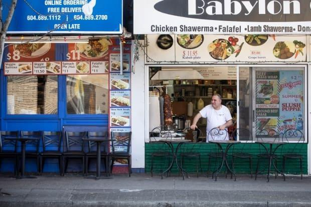 A restauranteur waits for customers in downtown Vancouver in March 2020. (Ben Nelms/CBC - image credit)