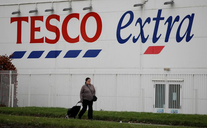 A woman walks past a Tesco extra superstore near Manchester, Britain January 8, 2020. REUTERS/Phil Noble