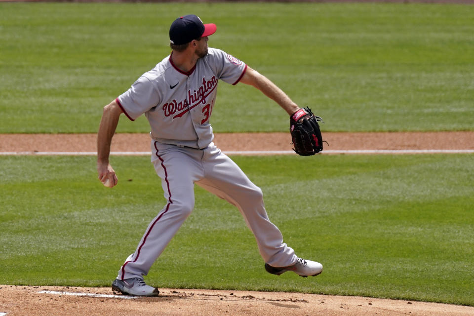 Washington Nationals starting pitcher Max Scherzer throws to the plate during the first inning of a baseball game against the Los Angeles Dodgers Sunday, April 11, 2021, in Los Angeles. (AP Photo/Mark J. Terrill)