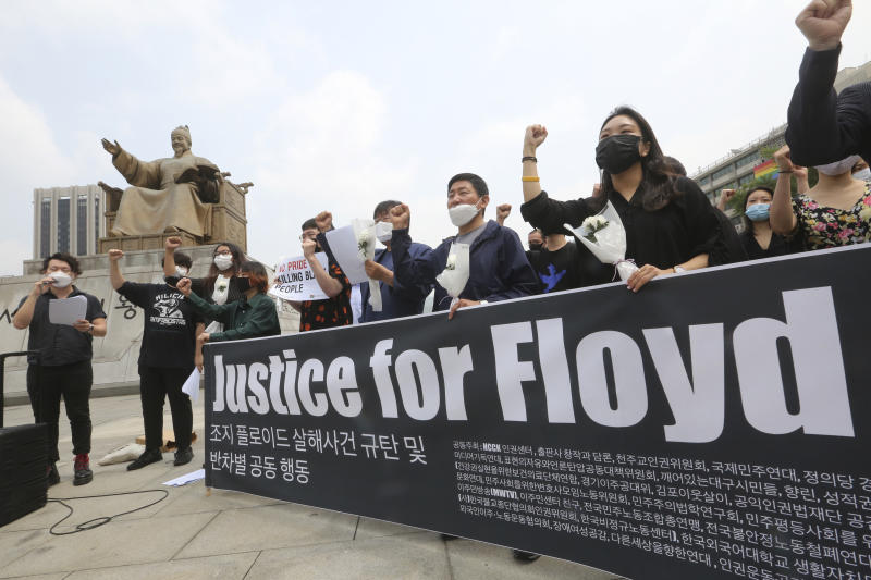 South Korean protesters stage a protest over the death of George Floyd, a black man who died after being restrained by Minneapolis police officers on May 25, near the U.S. embassy in Seoul, South Korea, Friday, June 5, 2020. (AP Photo/Ahn Young-joon)