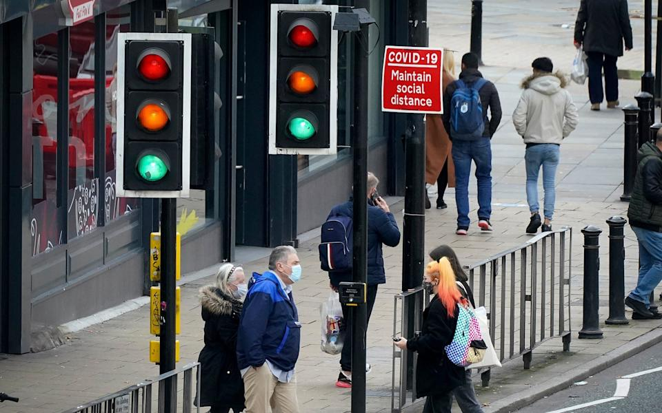 A sign warns pedestrians in Liverpool to maintain their social distance as coronavirus infection rates grow - Getty Images Europe/Christopher Furlong