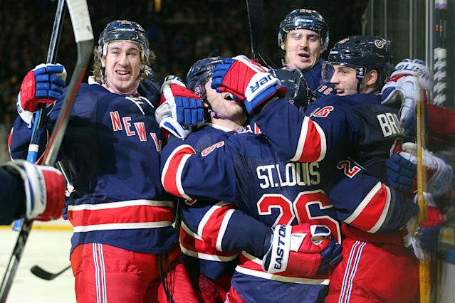 Nov 5, 2014; New York, NY, USA; New York Rangers center Derick Brassard (right) celebrates his game-winning goal against the Detroit Red Wings with teammates during the overtime period at Madison Square Garden. The Rangers defeated the Red Wings 4-3 in overtime. (Brad Penner-USA TODAY Sports)