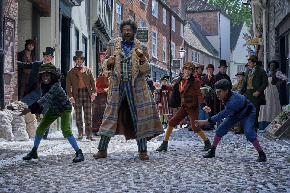 """Forest Whitaker and dancing townsfolk in """"Jingle Jangle: A Christmas Journey."""""""