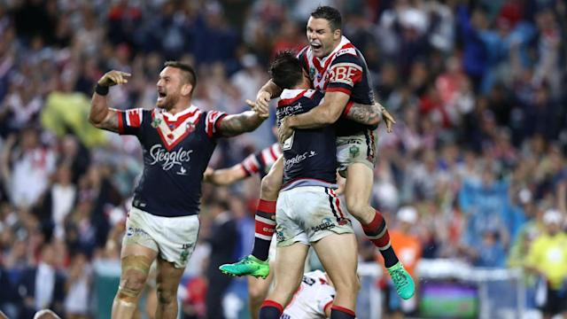 Mitchell Pearce scored his first drop goal since 2011 to settle a thrilling clash at Allianz Stadium before Melbourne Storm went top.