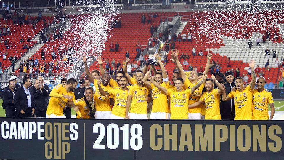 Tigres players celebrate their 3-1 win over Toronto FC in Wednesday's inaugural Campeones Cup between the MLS and Mexican champs.