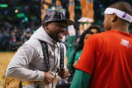 Floyd Mayweather talks with Isaiah Thomas of the Boston Celtics after a game on Jan. 29. (Getty)
