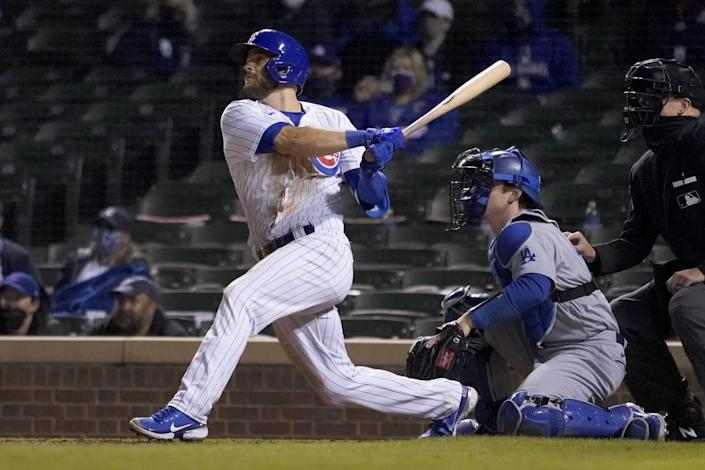 Chicago Cubs' David Bote watches his game winning RBI single off Dodgers relief pitcher Garrett Cleavinger.