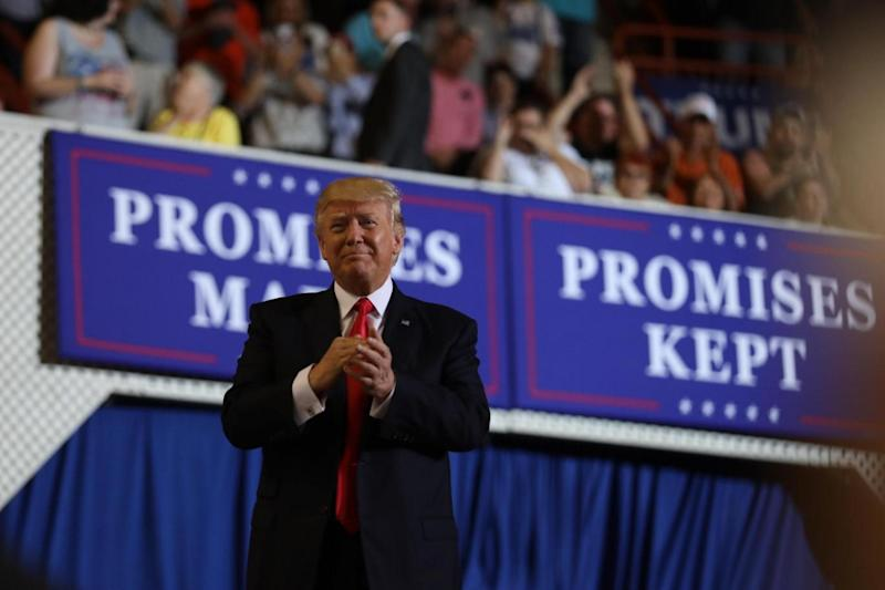 US President Donald Trump leads a rally marking his first 100 days in office in Harrisburg (REUTERS)
