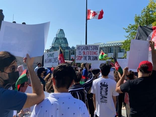 A protest in Ottawa against the Taliban's swift takeover over of Afghanistan on Aug. 14, 2021. The Hazara community in Halifax are planning a similar protest to raise awareness at the Peace and Friendship park on Aug. 25. (Celeste Decaire/CBC - image credit)