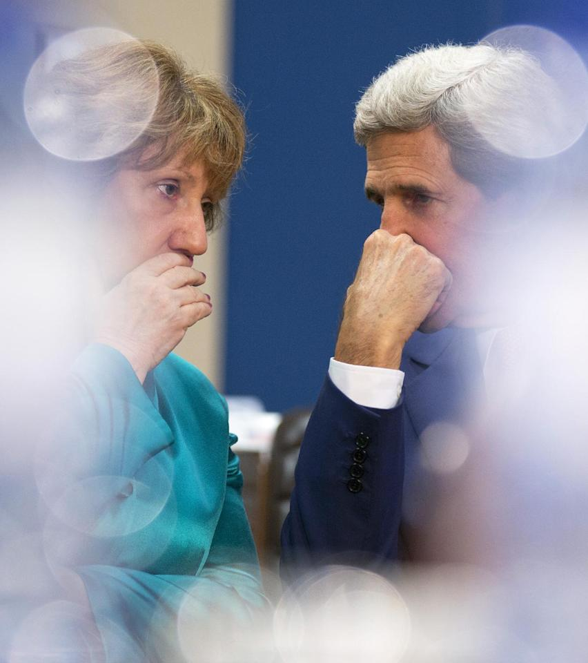 U.S. Secretary of State John Kerry, right, speaks with European Union High Representative Catherine Ashton during a meeting of the North Atlantic Council in Foreign Ministers Session at NATO headquarters in Brussels on Wednesday, June 25, 2014. The Brussels meeting is the final gathering of high-ranking government officials before the summit of NATO's leaders scheduled for September in Wales. U.S. Secretary of State John Kerry and his colleagues are expected to fine tune the summit's agenda on a wide array of topics, from how to redeploy NATO's forces in response to Russian capabilities and actions to what to do in Afghanistan when NATO's combat mission in that country comes to an end this December. (AP Photo/Virginia Mayo)