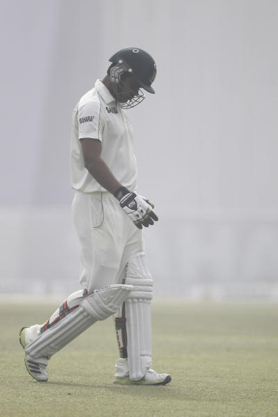 Bangladesh's Marshall Ayub returns to the pavilion after his dismissal by Sri Lanka's Suranga Lakmal on the fourth day of their first test cricket match in Dhaka, Bangladesh, Thursday, Jan. 30, 2014. (AP Photo/A.M. Ahad)