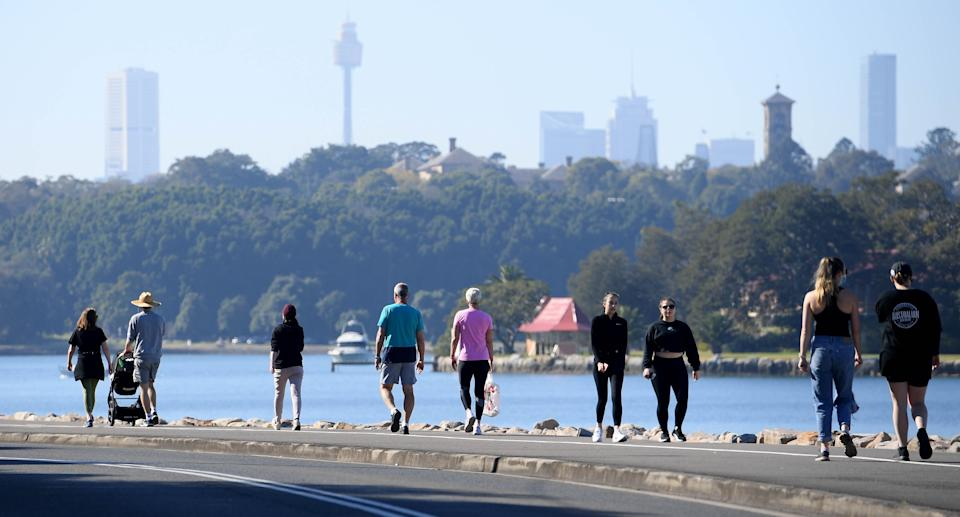 People are seen exercising at the Bay Run in Sydney, Saturday, August 14, 2021. Greater Sydney and surrounding regions are in lockdown until at least August 28 and the NSW Hunter will be locked down for a week as health authorities battle to contain an outbreak of the virulent Delta strain. (AAP Image/Dan Himbrechts) NO ARCHIVING