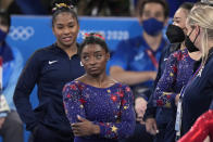 Simone Biles, of the United States, waits for her score after performing on the balance beam during the women's artistic gymnastic qualifications at the 2020 Summer Olympics, Sunday, July 25, 2021, in Tokyo. (AP Photo/Gregory Bull)